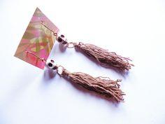 Zarcillos con calaveras y borlas.  http://www.facebook.com/flor.indumentaria