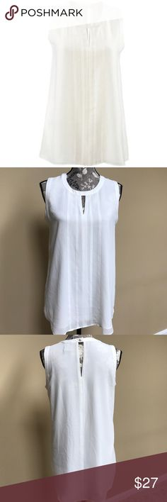 """Cabi Adore Blouse Cabi white Adore sleeveless blouse size small. Excellent preloved condition. A charming Sleeveless Top with double keyhole, sewn down pleats at the front and a button at the back. The white wardrobe staple is Tunic length in back with slightly shorter front. Double lined for opacity. 100% polyester. 18.5"""" from underarm to underarm and 26.5"""" long in front and 29"""" in back CAbi Tops Blouses"""