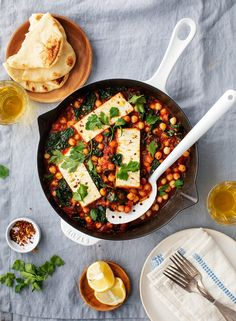 This baked feta is the easiest vegetarian dinner. Great for cold weeknights, it'… This baked feta is the easiest vegetarian dinner. Great for cold weeknights, it's a simple recipe made with cumin-spiced tomato sauce, chickpeas, and kale. Easy Vegetarian Dinner, Vegetarian Main Dishes, Vegetarian Recipes, Healthy Recipes, Chickpea Recipes, Kale Recipes, Recipes With Cumin, Recipes With Chickpeas, Baked Feta Recipe