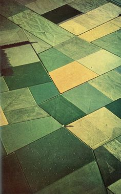 A view from an airplane of cultivated fields in the flat lands - land that is plowed or spaded and used for growing crops - looks like a patchwork quilt literally with various math - geometry shapes, as each crop has its distinct color. - http://www.pinterest.com/DianaDeeOsborne/logic-math-music