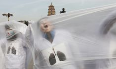 College students wearing masks pose with a plastic bag during a performance art performance to raise awareness of air pollution in Xi'an. Plastic Pollution, Air Pollution, A Level Photography, Pictures Of The Week, Photojournalism, Shanghai, Beijing, Beautiful Places, Skyline