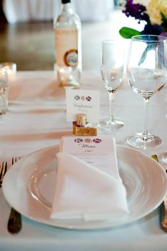 MOH: I like that the wedding menu is tucked in the napkin. Pretty but simple. We can add a flower to jazz it up. I want the menu itself to be fancier - more colors