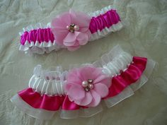 One to keep and one to toss - Pink and White garter set in satin and organza. Chiffon florals, with rhinestones and pearls, add bling. Toss Style 5 (top); Keepsake Style 9 with organza underlay (bottom).
