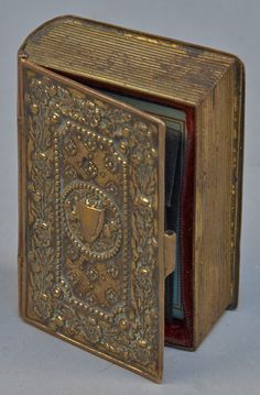 Book Shaped Metal Box w/ Antique Needle Case - VCA. #497. http://www.vcaauction.com/catalog.php