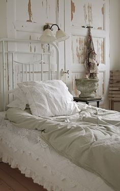 Simple white room, delicate white iron bed, white lace dust ruffle, linen duvet cover - charming. Love linen.