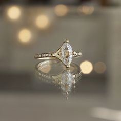 White Sapphire Marquise Cut and 14k Yellow Gold Diamond Engagement Ring at Sarah O. Jewelry   Denver, CO