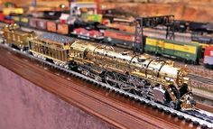 Lionel Train Layouts | Lionel trains, such as this gold 700E J-1E Hudson engine displayed at ...