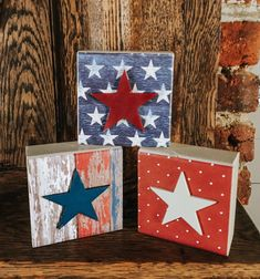 Farmhouse Stars & Stripes Trio Wooden blocks measuring approximately x and thick.Blocks painted in an Almond color with a rustic patriotic card stock decoupaged on the front. The stars have been laser cut, painted and applied to the blocks for a effect. July 4th Holiday, Fourth Of July Decor, 4th Of July Decorations, 4th Of July Party, Birthday Decorations, Table Decorations, Americana Crafts, Patriotic Crafts, Patriotic Party