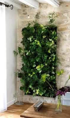 do you want to decorate it? the best way to that is to create a vertical garden wall inside your home. A vertical garden wall, also called a living wall, is a collection of… Continue Reading → Jardin Vertical Artificial, Artificial Plants, Herb Garden Design, Diy Garden, Vertical Garden Wall, Vertical Gardens, Vertical Bar, Indoor Plant Wall, Indoor Plants
