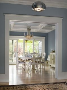 Stunning and simple dining room with cool blue walls.