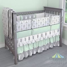 Crib bedding in Silver Gray and White Deer Head, Natural Minky Chenille, White and Gray Arrow, Solid Icy Mint, Solid Cloud Gray, Silver Gray Deer Head. Created using the Nursery Designer® by Carousel Designs where you mix and match from hundreds of fabrics to create your own unique baby bedding. #carouseldesigns
