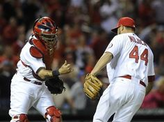 Yadier Molina and Edward Mujica,  celebrate their victory over the New York Mets.  5-13-13