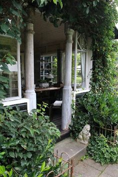 Villa 'Rosa' in Sweden. I love these columns, they are not hard to find in antique stores, and make such a statement.