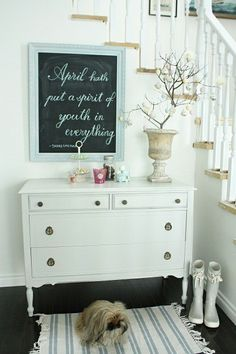 a chalk board  on an entry table/dresser