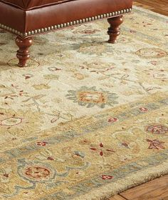 Enliven your home with the stunning floral motif of the Bellingrath Area Rug; constructed of 100% plush hand-twisted pool pile for comfort and durability.