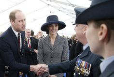 Kate Middleton Photos Photos - Prince William, Duke of Cambridge shakes hands as Catherine, Duchess of Cambridge smiles as they meet veterans and serving members of the British armed forces at a reception following the unveiling of the new memorial to members of the armed services who served and died in the wars in Iraq and Afghanistan at Victoria Embankment Gardens on March 9, 2017 in London, England. - Dedication