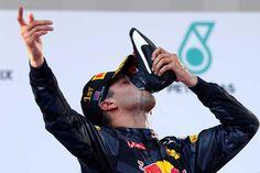 Daniel Ricciardo / Red Bull Racing celebrates his victory in the Malaysian F1 Grand Prix at Sepang Circuit