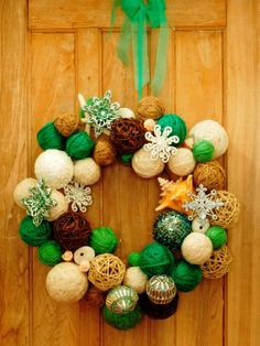 How to Make a Cottage-Style Yarn Ball Wreath : Home Improvement : DIY Network Perfect for the holidays. Made by Joanne Palmisano, author of Salvage Secrets, photograph by Susan Teare Diy Christmas Decorations Easy, Christmas Ornaments To Make, Holiday Wreaths, All Things Christmas, Holiday Crafts, Christmas Crafts, Holiday Decor, Wreath Crafts, Ornament Wreath