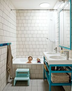 Modern bathroom with irregular tiled wall
