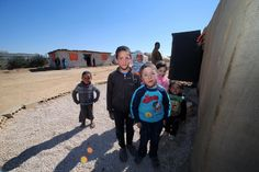 Syrian refugee children play in a Jordanian community as Zaatari camp is seen in the background, in the village of Zaatari, Jordan.  12 February 2014 Photo: Salah Malkawi/UNDP