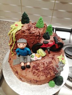 Mountain bike madeira cake with sugar paste bike, biker & packed lunch! Covered with chocolate buttercream.