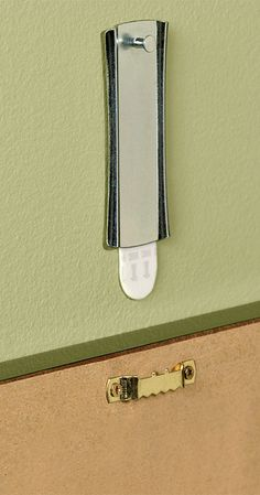 A 3M Command Hook to hold up curtain rod. Perfect when you ...