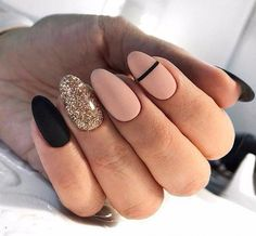 Nude nails with black and gold glitter