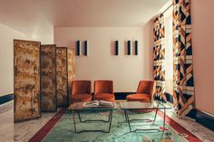 Reception and communal area with Art Deco patterned curtains - Art Deco inspired designs of the Hotel Saint Marc luxury boutique hotel in central Paris, France. Retro Interior Design inspiration and images from the hotel featured on the Martyn White Designs Blog