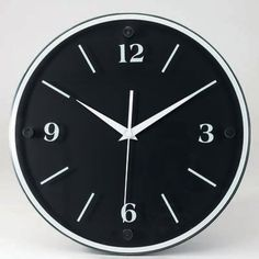 "This 12"" Round Wood Wall Clock will automatically self-adjust for Daylight Saving Time, eliminating the hassle of taking down and resetting the clock twice each year! A tiny CPU chip which is programmed with the DST dates for the next 99 years is built into the reliable quartz movement . Once the clock is set, the hands will automatically move forward or backward to adjust for Daylight Saving Time on the correct days each year. Features a large black wood frame and a glass face with chro..."