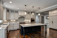Traditional Kitchen with Fireclay Tile White Wash, Limestone Tile, Pendant Light, Imperial Danby, Marble, Custom hood