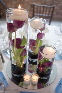 Wedding table flowers. Submerged tulips (or any flower you love) with floating candle.