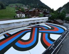 Painted with road marking paint—traditionally used to create permanent road signage—the 59 x 3.9-meter artwork provides a visually exciting ...