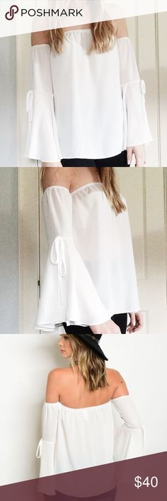 Off Shoulder Bell Tie Sleeve Top in White Cutest little woven off the shoulder top with bell sleeves and tie detailing! Boutique brand, new without tags. Available in sizes Small, Medium, and Large. Boutique Tops Blouses
