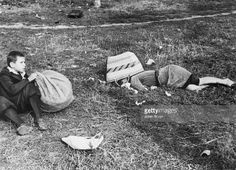 The mother of a young Polish boy lies dead in a potato field near Warsaw during the Nazi invasion of Poland.