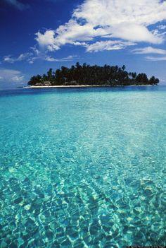 Take a dip in the crystal clear waters off Dog Island, San Blas, Panama