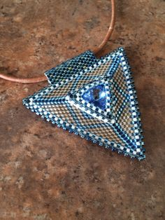 Denim blue triangle pendant by BeadSplashHCJ on Etsy, $35.00