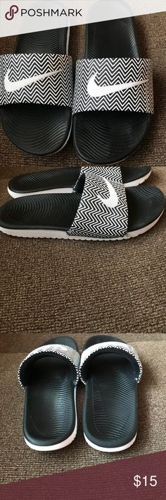 Nike black and white Sandals. Size 8 Nike black and white Sandals. Only wore a handful of times. Great condition. A little dirt on the bottoms. Fits 7-8 Nike Shoes Sandals