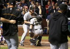 Pirates clinch 1st playoff berth in 21 years  - Pittsburgh Pirates relief pitcher Jason Grilli, left, picks up catcher Russell Martin after a baseball game and Pirates 2-1 win over the Chicago Cubs Monday, Sept. 23, 2013, in Chicago. (AP Photo/Charles Rex Arbogast)