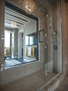 The shower stall is clad floor to ceiling in a mix of tumbled marble and glass mosaic tile. A window, carved into the wall, provides views into the master bedroom and through windows beyond.  #HGTVUrbanOasis  http://www.hgtv.com/urban-oasis/hgtv-urban-oasis-2013-master-bathroom-pictures/pictures/page-4.html?soc=pinterest