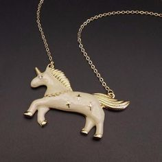 The enamel style necklace makes great unicorn gifts. Having a trendy fashion design, these unicorn gifts are sure to please. The beige (blue and pink also available, see our website)unicorn gift necklace has an enamel metal jewelry design that shows a silhouette side view. Unicorn Shops gifts include this necklace which has a fashionable look that can go with many things. We offer a wideselection of unicorn gifts, one of the widest selections for a specialty internet store.