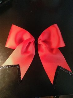 Red 3 inch grosgrain cheerleading bow with black shimmer tips and center tie. on Etsy, $8.50