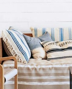 13 Chic IKEA Hacks for Your First Apartment via @mydomaine Softly nautical-inspired pillows in linens and blues never go out of style. These, made from IKEA's Signe rugs, are DIY gold.