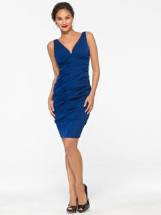 This dress is deceptively seductive. A deep v-neck and ruching bring out your shape while the inky navy shade is pure magic.V-neckAll-over heavy ruchingBack zip40 inch body length72% Acetate, 25% Nylon, 3% Elastane Lining: 100% PolyesterMade in the USADry clean only