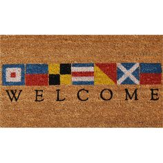 Featuring a flag motif, this lovely coir doormat lends a nautical touch to your beach house.  Product: DoormatConstr...