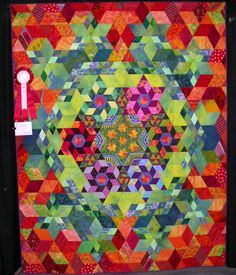 """""""Twist and Shout"""" by the Out of Towners, Knoxville, TN. 2007 Smoky Mountain Quilters show.  2nd prize, group quilt."""