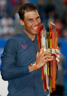 Rafael Nadal of Spain poses with the trophy after winning the Mubadala World Tennis Championship at Zayed Sport City on December 31 2016 in Abu Dhabi...