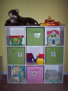 Love the fabric bins for toy storage.