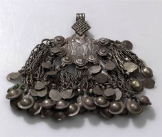 Afghanistan | Clothes ornament; metal (coin, chain) | Acquired 2006. Locale; Waygal