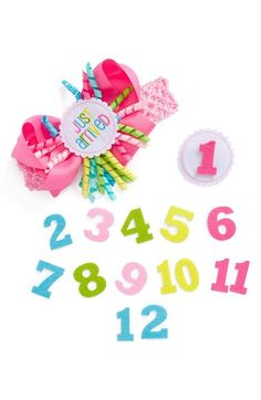 """Free shipping and returns on Mud Pie 'Monthly Milestone' Headband (Baby Girls) at Nordstrom.com. Celebrate baby's monthly milestones in style with this cute grosgrain headband fronted with a darling felt medallion that says """"Just Arrived."""" Every month after, switch out the medallion for interchangeable numbers to match her age and ensure she's ready for her close-up."""