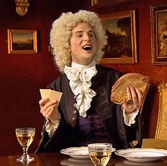 """Lord Sandwich invents the Sandwich! Inventive Git!  It is said that during a card game John Montague, 4th Earl of Sandwich ordered his valet to bring him meat tucked between two pieces of bread. Others began to order """"the same as Sandwich!"""" The original sandwich was, in fact, a piece of salt beef between two slices of toasted bread. [Ben Willbond as Lord Sandwich - Horrible Histories Gorgeous Georgians. (c) CBBC]"""